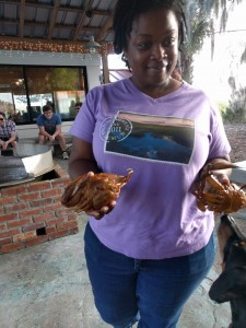 Shauna, our Pin Point tour guide holding blue crabs