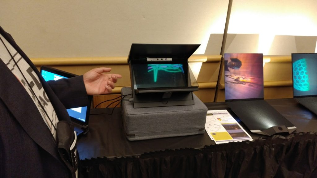 Eric Kurland shows off an interactive 3D hologram prototype.